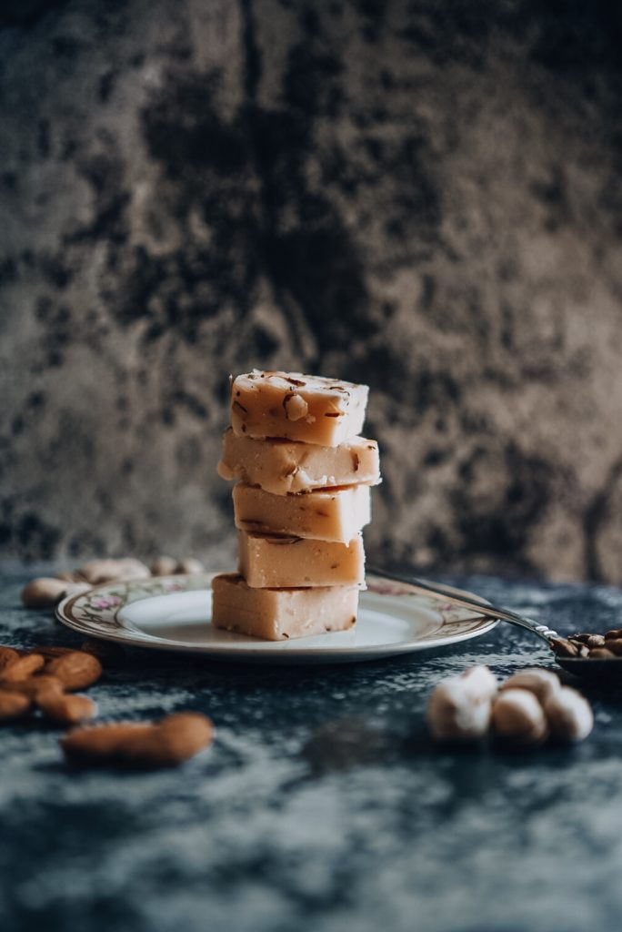 This easy to make almond fudge almond known as badam burfi recipe is sure to be a hit! We recommend making a batch of this almond burfi for your next get-together and is one of our favorite indian desserts that can be made quickly!